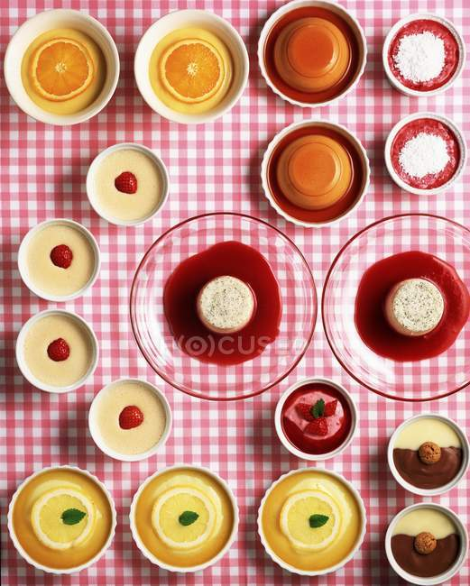Assorted puddings and mousses — Stock Photo