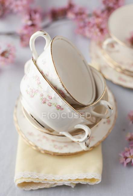 Closeup view of empty soup bowls with pink flowers — Stock Photo