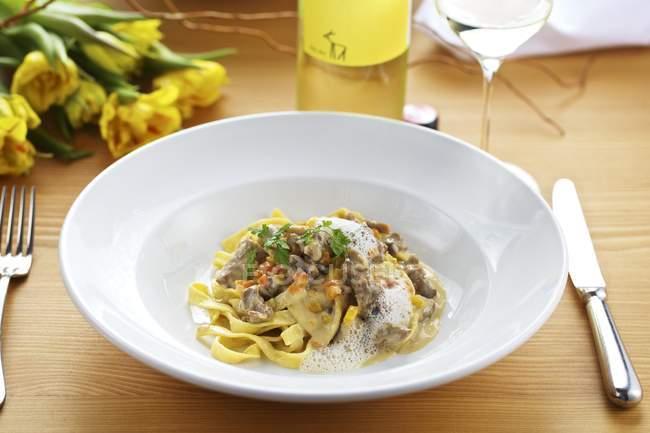 Goat ragout on homemade tagliatelle pasta — Stock Photo