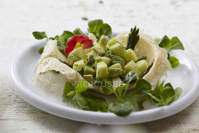Parmesan basket with avocado — Stock Photo