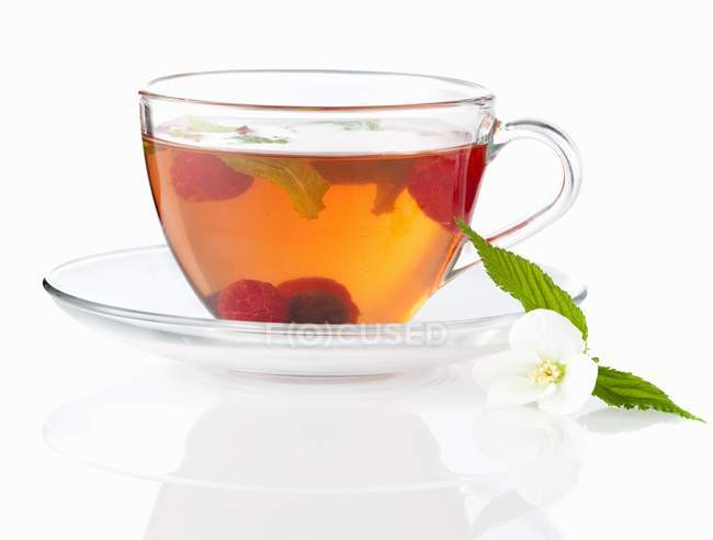 Fruit tea with raspberries and blueberries — Stock Photo