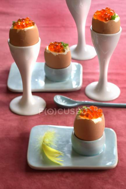 Closeup view of soft-boiled eggs with caviar in eggcups — Stock Photo