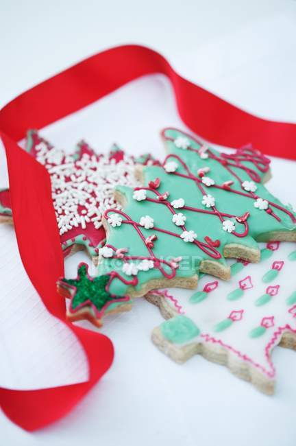 Decorated biscuit in shape of Christmas tree — Stock Photo