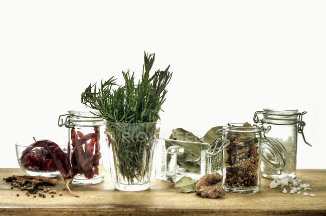 Sill life with assorted herbs and spices in glass containters — Stock Photo