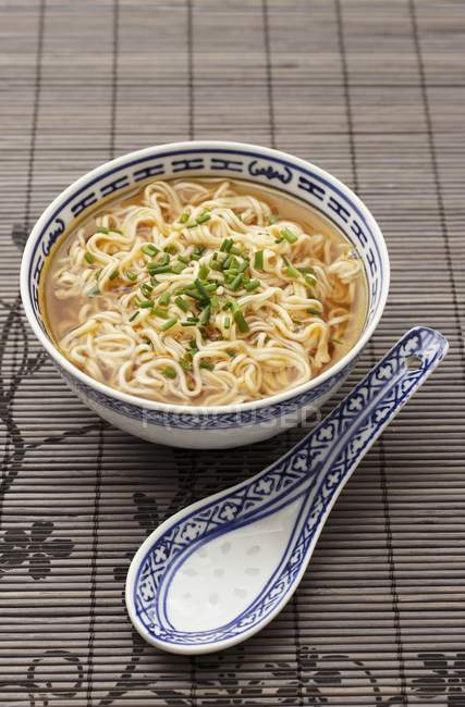 Noodle soup with chopped chives — Stock Photo
