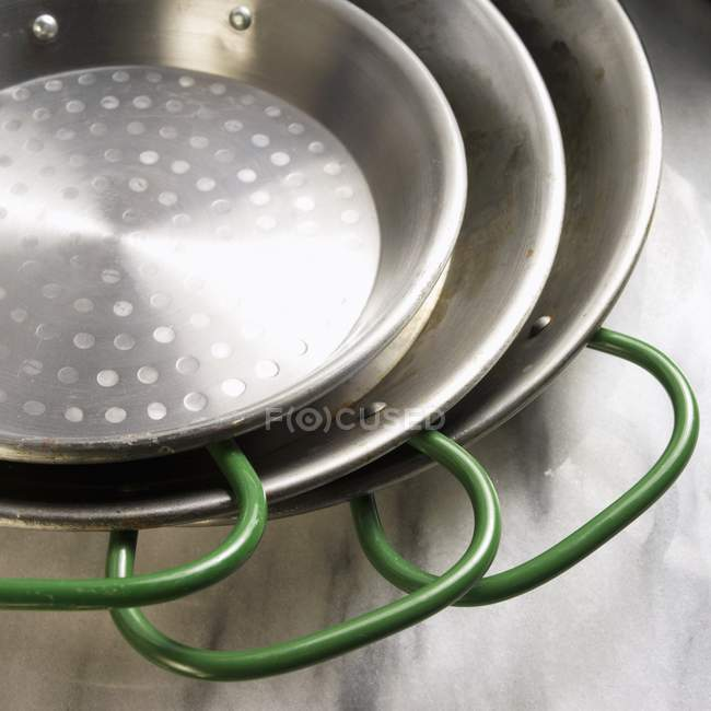 Closeup view of three green handled pans — Stock Photo