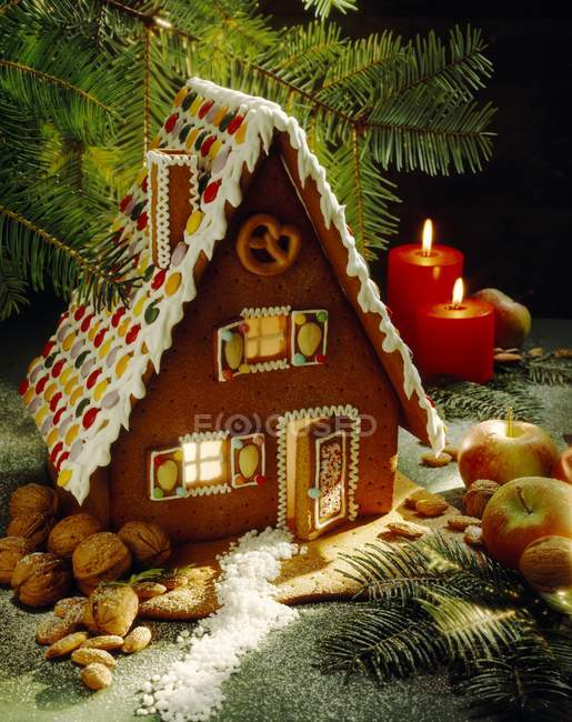 Gingerbread house with candles — Stock Photo
