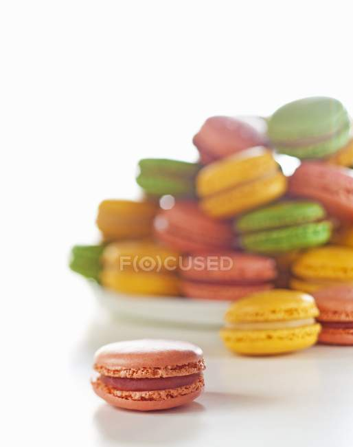 Colourful macaroons and plate — Stock Photo