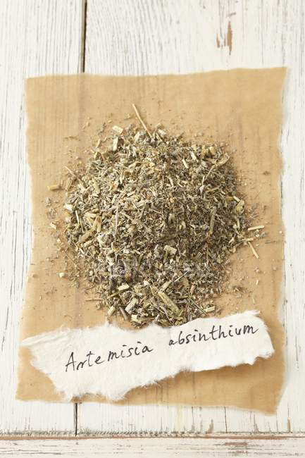 Closeup top view of dried wormwood on paper with tag — Stock Photo