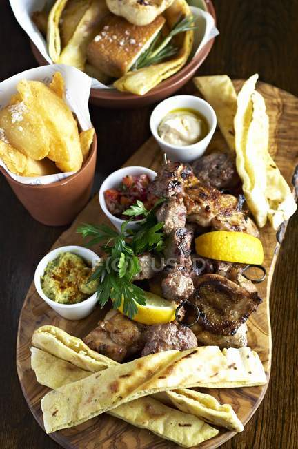 Mixed grill with dips — Stock Photo