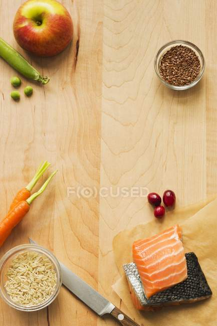 Fresh salmon with assorted ingredients — Stock Photo