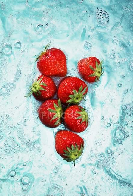 Fresh Strawberries in water — Stock Photo