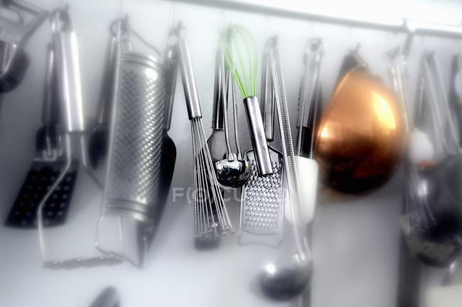 Closeup View Of Assorted Kitchen Implements Hanging On Wall U2014 Stock Photo