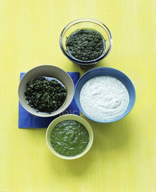 Assorted pestos and sauce — Stock Photo