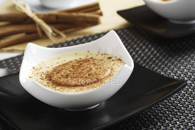 Custard with cinnamon and crackers — Stock Photo
