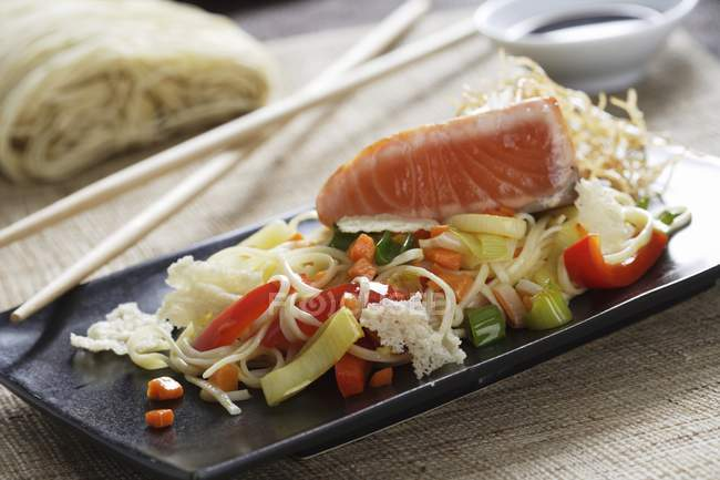 Noodles and salmon fillet — Stock Photo