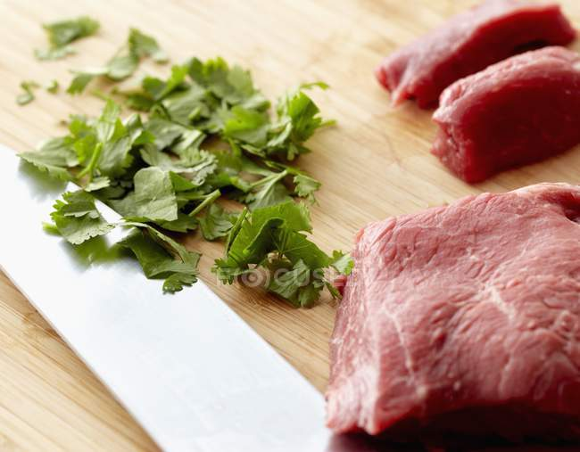 Raw Beef and Chopped Cilantro — Stock Photo