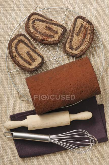 Top view of sliced chocolate Swiss roll — Stock Photo