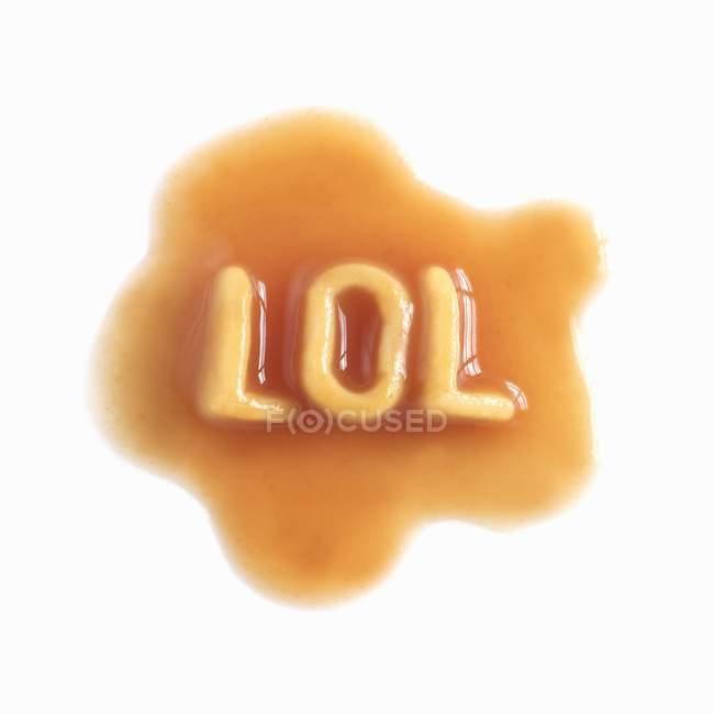 Lettres de pâtes en sauce — Photo de stock