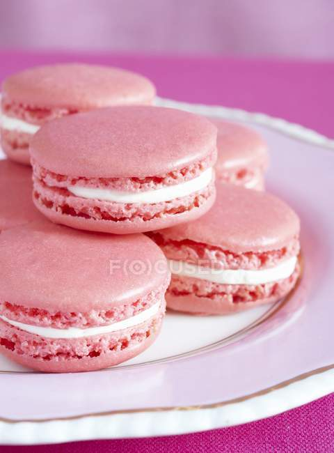 Pink macaroons on plate — Stock Photo