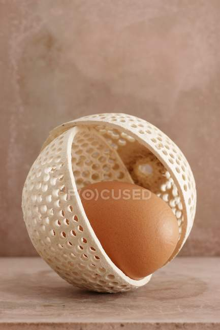brown egg in ornate bowl stock photo 154124026