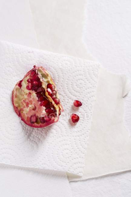 Chunk of pomegranate and seeds — Stock Photo