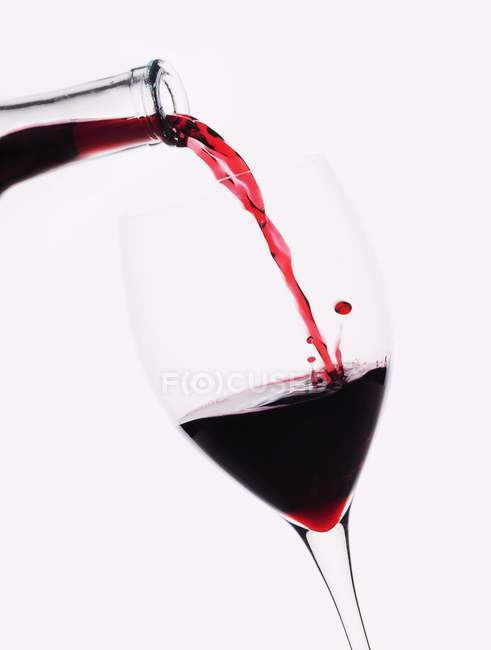 Red wine poured into glass — Stock Photo