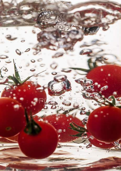 Cherry tomatoes in water — Stock Photo