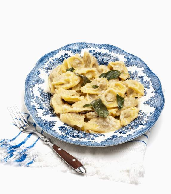 Agnolotti pasta with basil leaves — Stock Photo