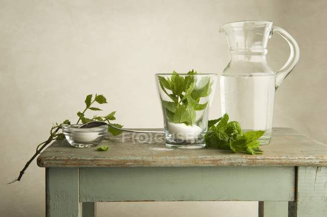 Ingredients for peppermint tea on a wooden table — Stock Photo