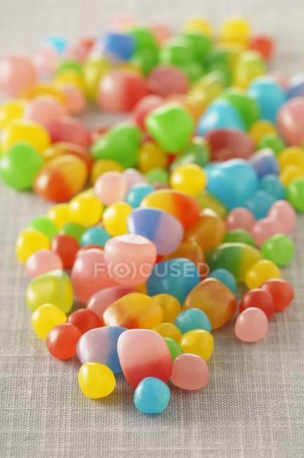 Closeup view of colorful sweets heap on cloth — Stock Photo