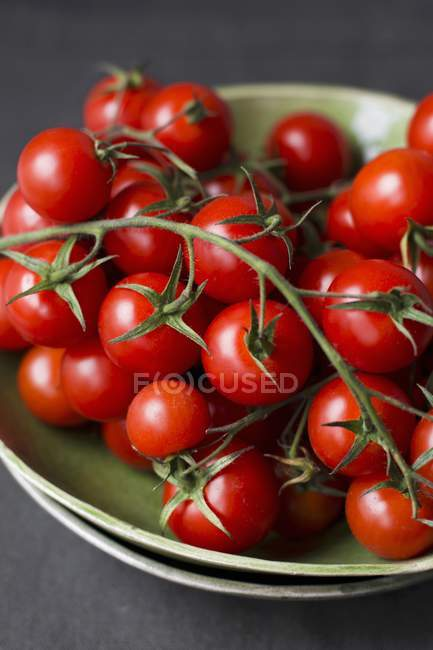 Red Cherry tomatoes on vine — Stock Photo