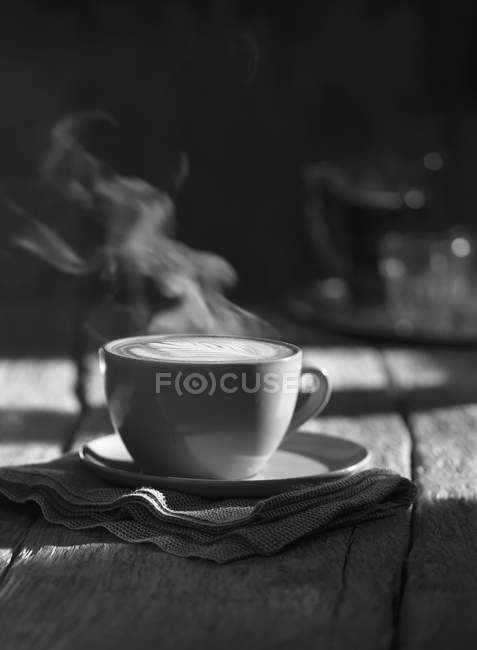 Cup of steaming cappuccino — Stock Photo