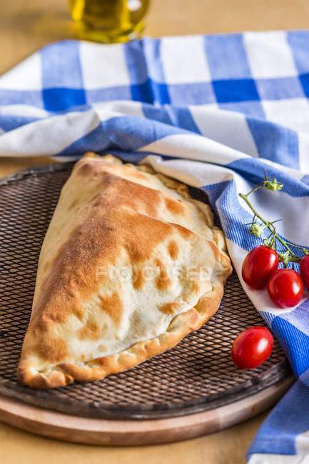 Pizza pocket with tomatoes — Stock Photo