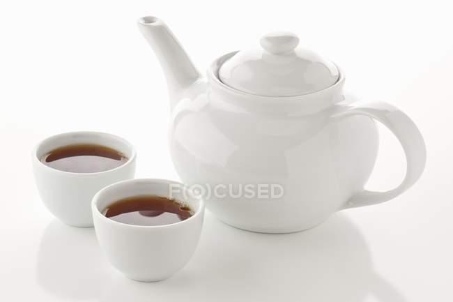 Азиатский чай в чайник и чай миски — стоковое фото
