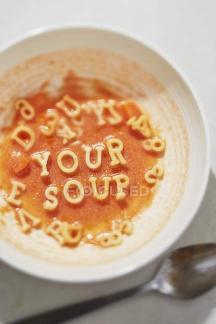 Tomato soup with alphabet pasta — Stock Photo