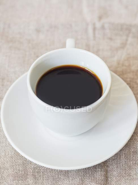 Cup of red espresso — Stock Photo