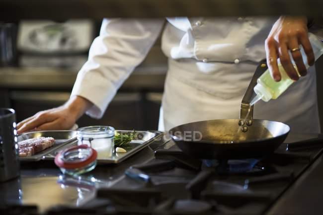 Chef preparing steak — Stock Photo