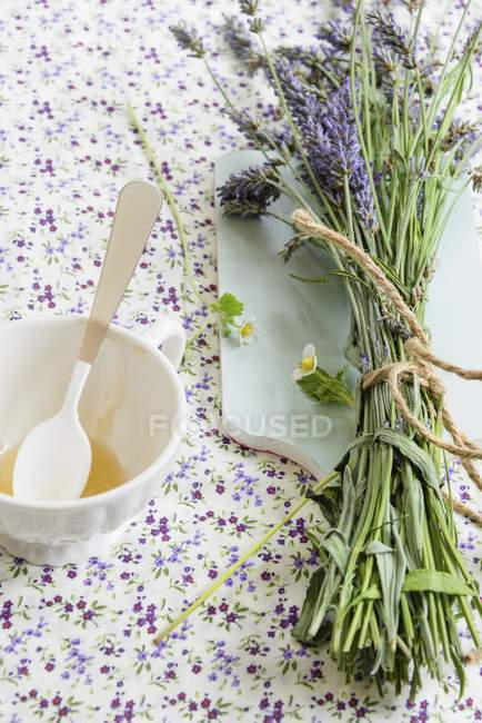 Lavender and honey in glass — Stock Photo