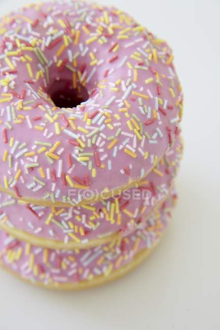Pink iced doughnuts — Stock Photo