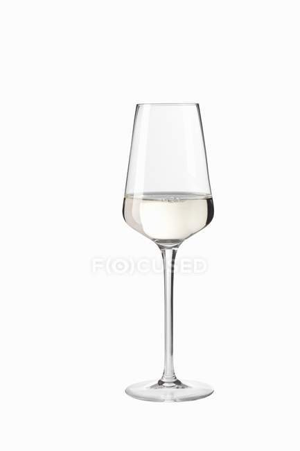 Closeup view of digestif glass on white surface — Stock Photo