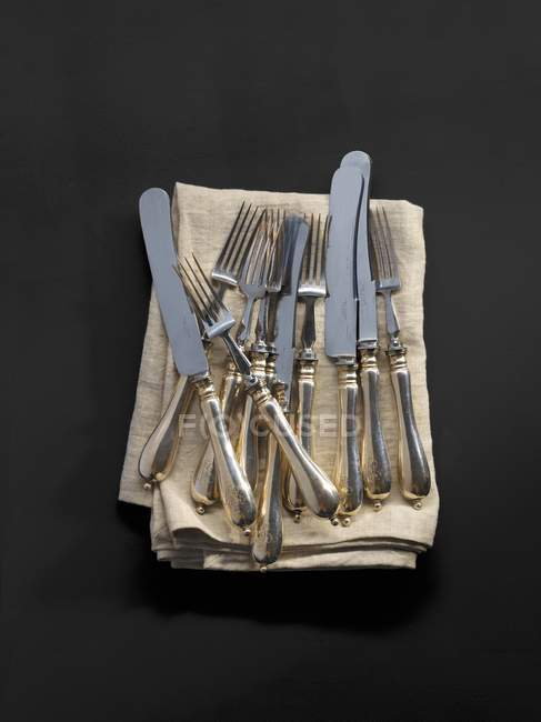 Top view of antique cutlery on a fabric napkin — Stock Photo