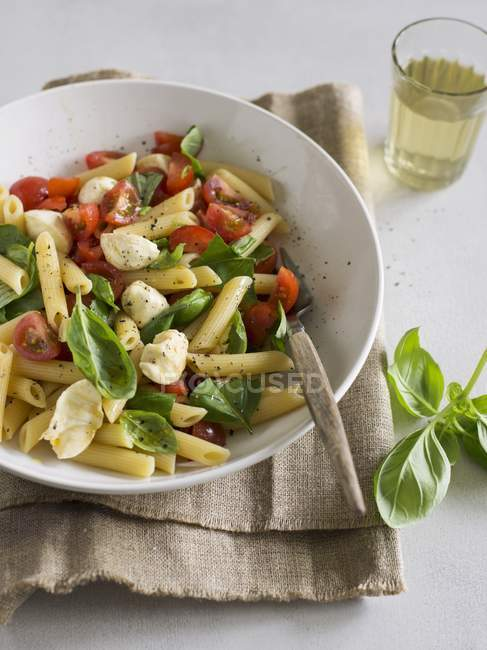 Caprese penne pasta salad — Stock Photo