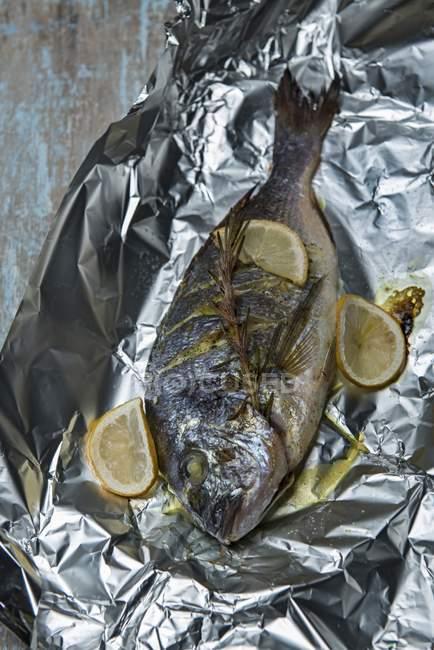 Sea bream roasted in aluminium foil — Stock Photo
