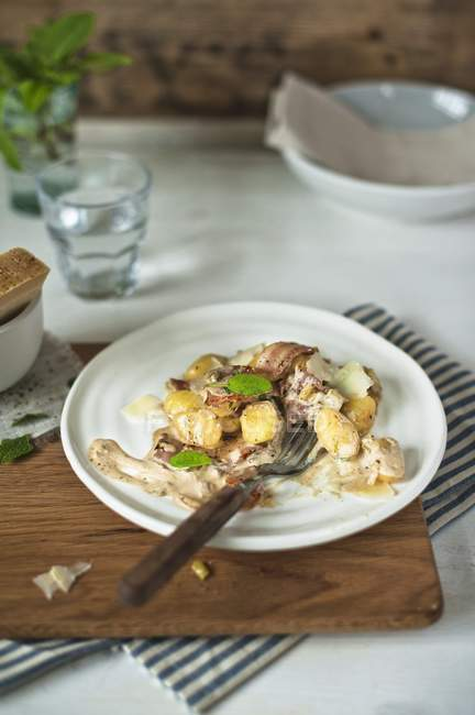 Elevated view of Gnocchi with a creamy mushroom sauce, bacon and sage — Stock Photo