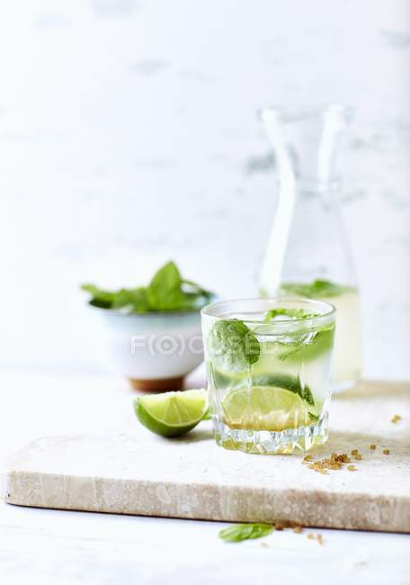 Mojito with limes and mint in glasses — Stock Photo