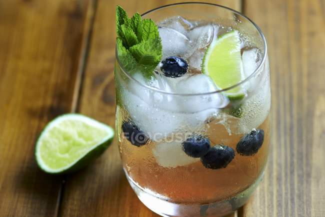 Mojito with blueberries and ice cubes — Stock Photo
