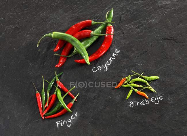 Various chilli peppers — Stock Photo