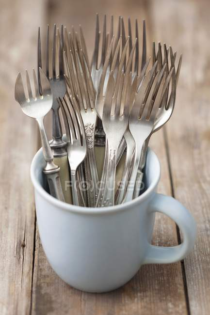 Closeup view of old forks in a cup — Stock Photo