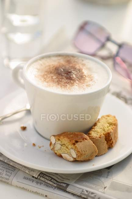 Cup of Cappuccino with cantuccini — Stock Photo